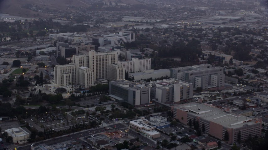 8K aerial video of the General Hospital building at USC Health Sciences Campus in Boyle Heights, Los Angeles, California at sunrise Aerial Stock Footage | AX0156_094