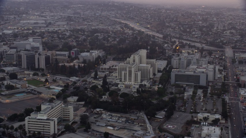 8K stock footage aerial video of General Hospital and USC Health Sciences Campus buildings in Boyle Heights, Los Angeles, California at sunrise Aerial Stock Footage | AX0156_095