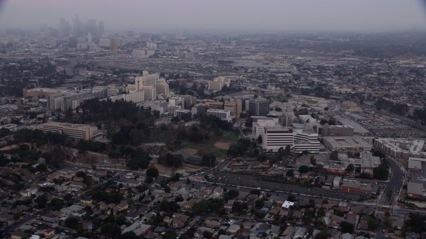 8K stock footage aerial video flying by University of Southern California Health Sciences Campus in Boyle Heights, Los Angeles, California at sunrise Aerial Stock Footage | AX0156_099