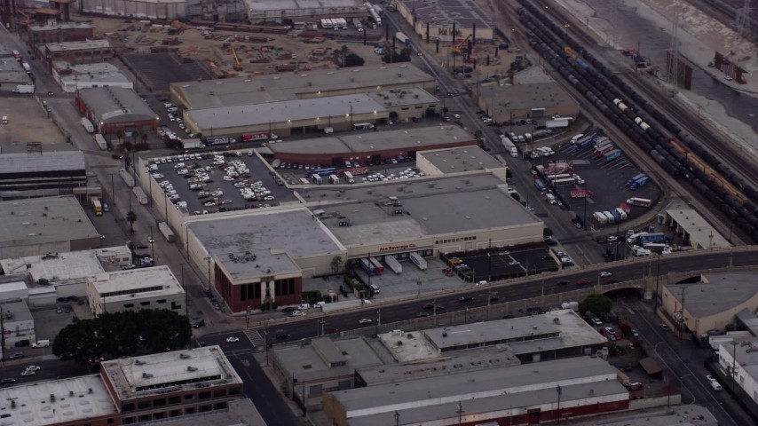 8K stock footage aerial video of warehouse building by the Fourth Street Viaduct in Boyle Heights, Los Angeles, California at sunrise Aerial Stock Footage | AX0156_101