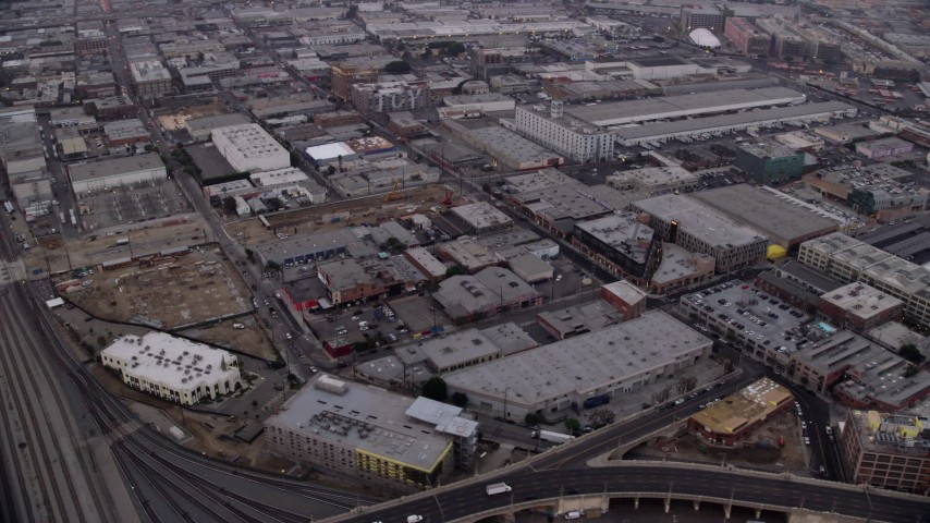 8K stock footage aerial video of warehouse buildings in the Arts District of Downtown Los Angeles, California at sunrise Aerial Stock Footage | AX0156_102