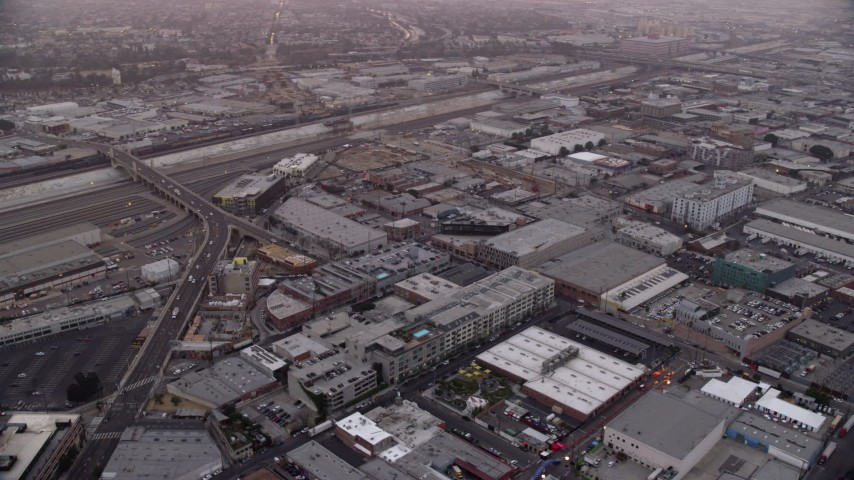 8K stock footage aerial video of warehouse and apartment buildings in the Arts District of Downtown Los Angeles, California at sunrise Aerial Stock Footage | AX0156_103