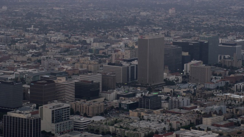 8K stock footage aerial video of office buildings and the Equitable Life Building in Koreatown, Los Angeles, California at sunrise Aerial Stock Footage | AX0156_107