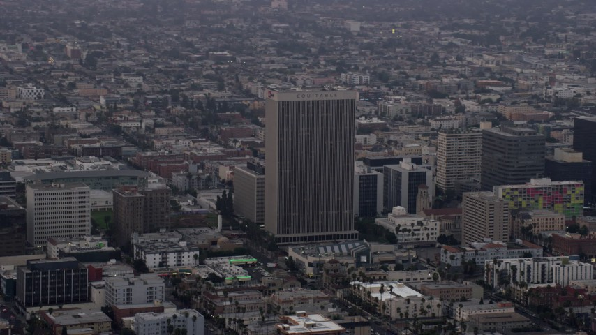 8K stock footage aerial video of the Equitable Life Building in Koreatown, Los Angeles, California at sunrise Aerial Stock Footage | AX0156_108