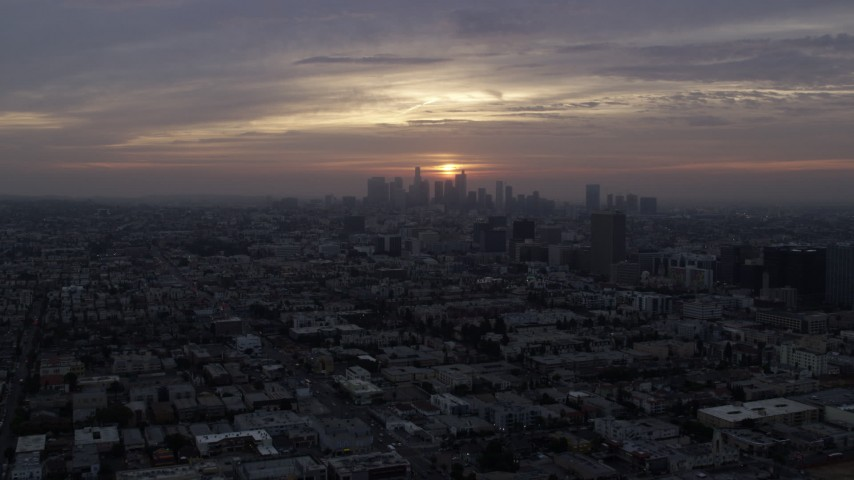 8K aerial video approaching Koreatown office buildings and the skyline of Downtown Los Angeles, California at sunrise Aerial Stock Footage AX0156_109