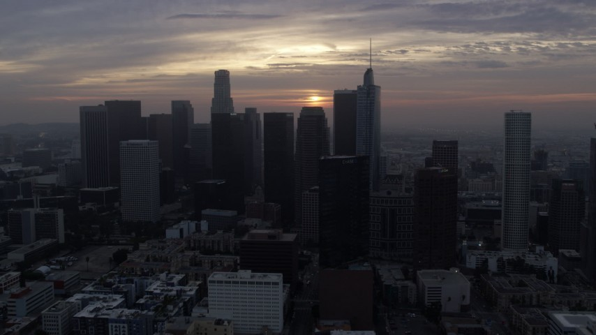8K stock footage aerial video approaching the tall towers of Downtown Los Angeles, California at sunrise Aerial Stock Footage | AX0156_112