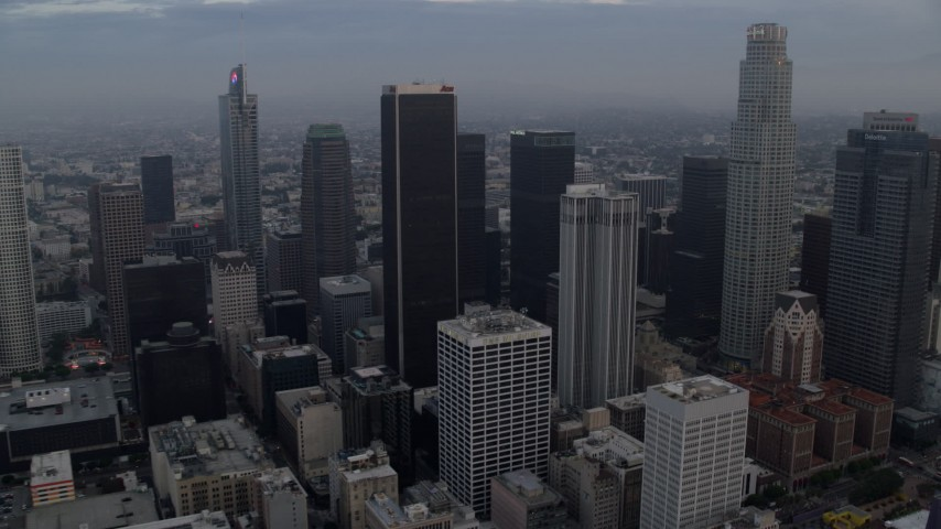 8K stock footage aerial video flying through Downtown Los Angeles, California at sunrise, and reveal Westlake Aerial Stock Footage AX0156_115 | Axiom Images