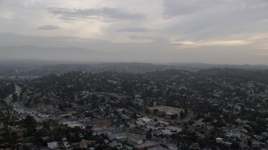 8K stock footage aerial video flying by residential neighborhoods in Echo Park and Silver Lake at sunrise, Los Angeles, California Aerial Stock Footage | AX0156_117