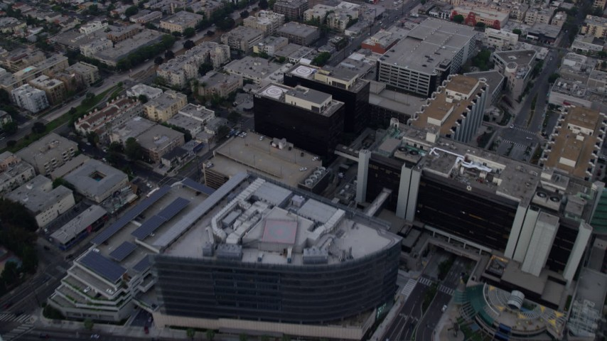8K stock footage aerial video flying over mansions to approach Beverly Center and Cedars-Sinai Medical Center at sunrise in Beverly Hills, California Aerial Stock Footage | AX0156_121