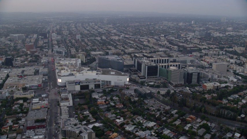 8K aerial video orbit of Beverly Center and Cedars-Sinai Medical Center at sunrise, Beverly Hills, California Aerial Stock Footage | AX0156_122