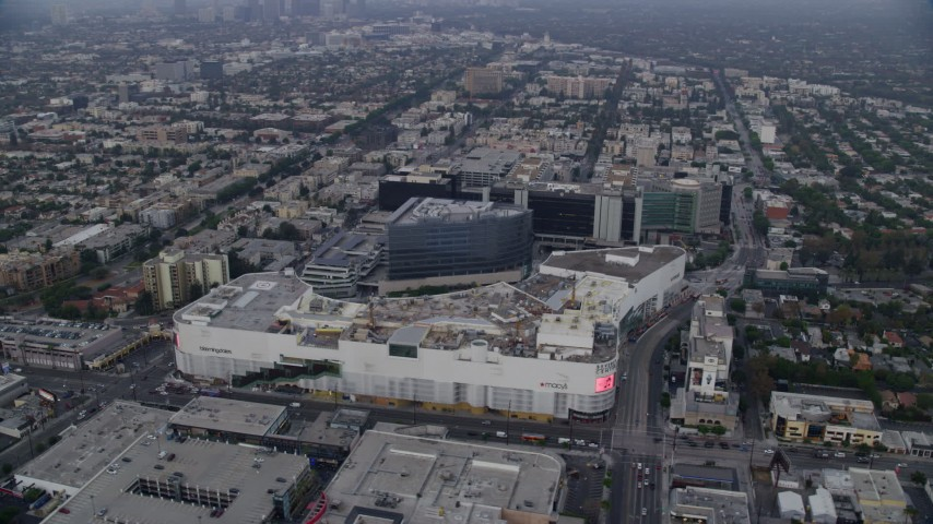 8K stock footage aerial video orbiting Beverly Center and Cedars-Sinai  Medical Center at sunrise, Beverly Hills, California
