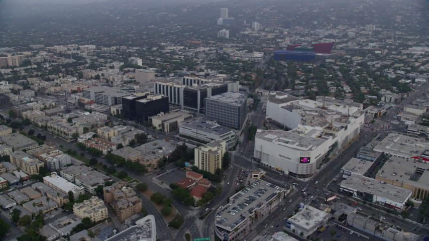 8K stock footage aerial video circling around Beverly Center and Cedars-Sinai Medical Center at sunrise, Beverly Hills, California Aerial Stock Footage | AX0156_124