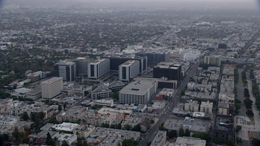 8K stock footage aerial video orbiting Cedars-Sinai Medical Center at sunrise in Beverly Hills, California Aerial Stock Footage | AX0156_125