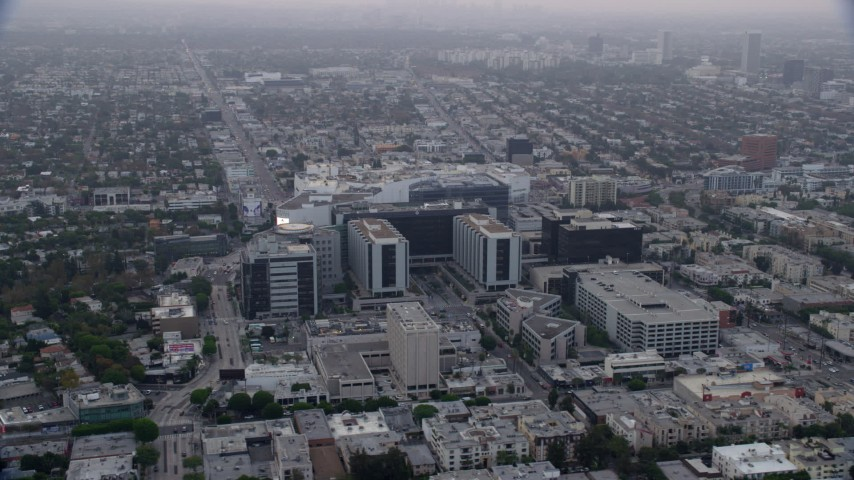 8K stock footage aerial video orbiting Cedars-Sinai Medical Center and Beverly Center, sunrise, Beverly Hills, California Aerial Stock Footage | AX0156_126