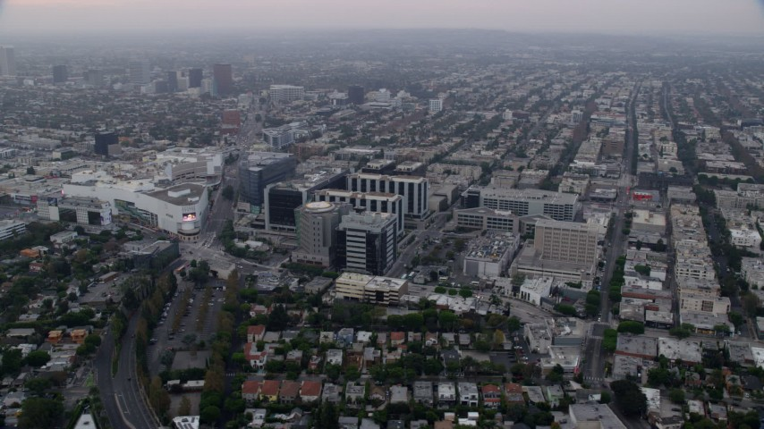8K stock footage aerial video orbiting Beverly center and Cedars-Sinai Hospital, sunrise, Beverly Hills, California Aerial Stock Footage | AX0156_127