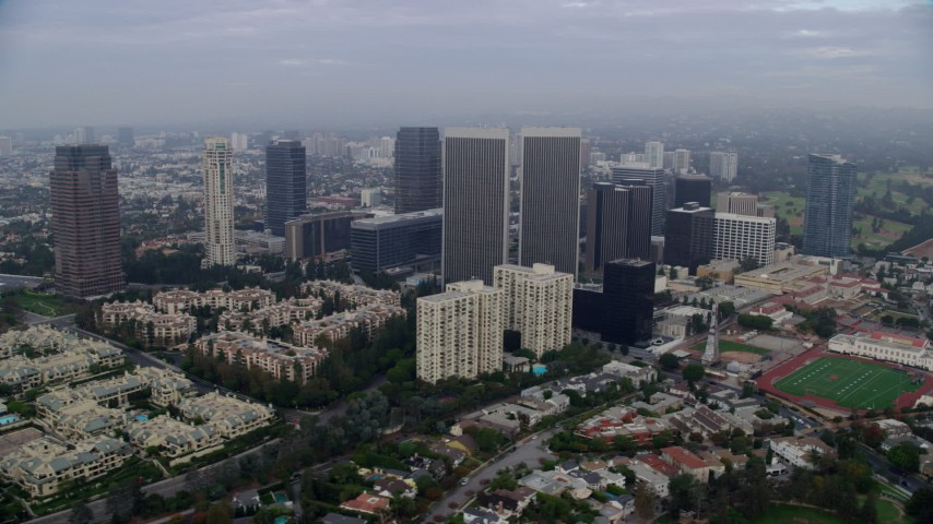 8K stock footage aerial video of condominiums and skyscrapers near Beverly Hills High School, sunrise, Century City, California Aerial Stock Footage | AX0156_136