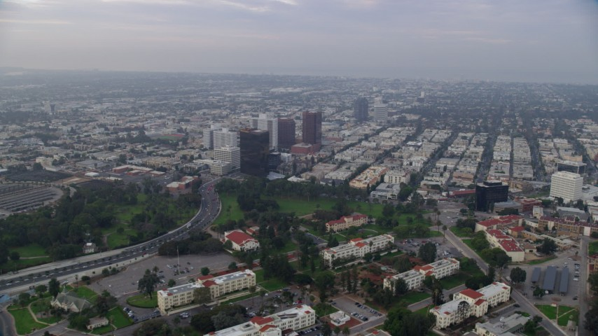 8K stock footage aerial video flying over Interstate 405 and apartment buildings following Wilshire Boulevard, sunrise, Sawtelle, California Aerial Stock Footage | AX0156_141