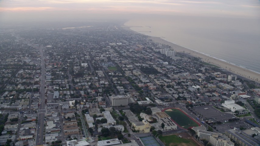 8K stock footage aerial video flying over coastal community with Venice & Marina Del Rey in distance, sunrise, Santa Monica, California Aerial Stock Footage AX0156_150 | Axiom Images