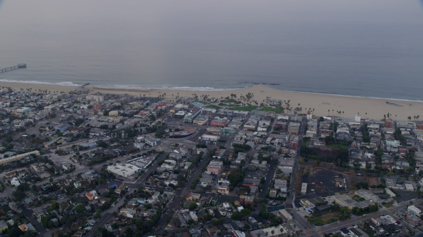 8K aerial video of Venice Beach and Windward Plaza at sunrise in Venice, California Aerial Stock Footage | AX0156_152