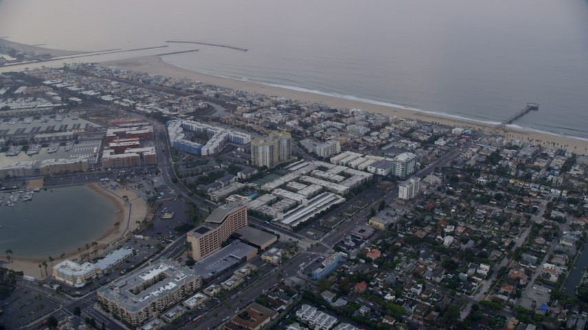 8K aerial video flying over Venice toward Marina Del Rey condominium complexes at sunrise, California Aerial Stock Footage | AX0156_153