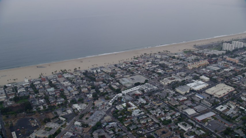 8K aerial video passing homes by the beach at sunrise, Venice, California Aerial Stock Footage | AX0156_154