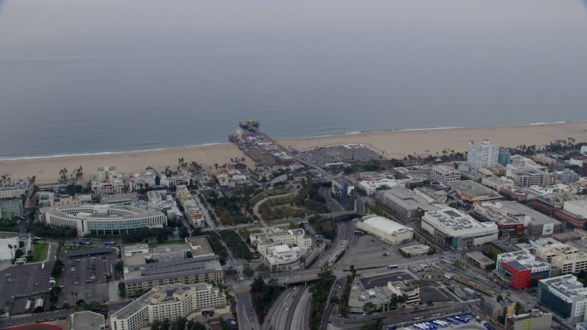 8K stock footage aerial video of beachfront shops near Santa Monica Pier in the morning, Santa Monica, California Aerial Stock Footage | AX0156_157