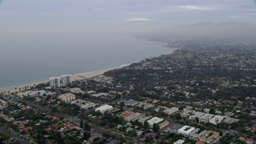 8K aerial video flying over neighborhoods in Santa Monica and Pacific Palisades, California in the morning Aerial Stock Footage | AX0156_159