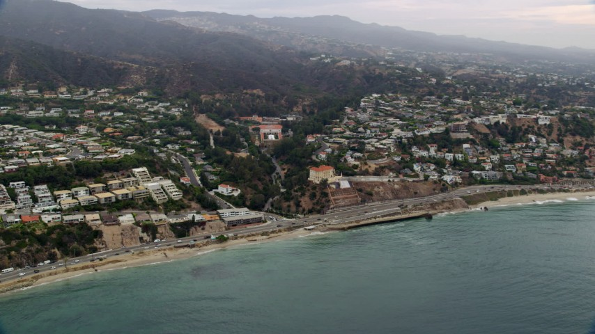 8K stock footage aerial video of light morning traffic on Pacific Coast Highway in Pacific Palisades, California Aerial Stock Footage   AX0156_165