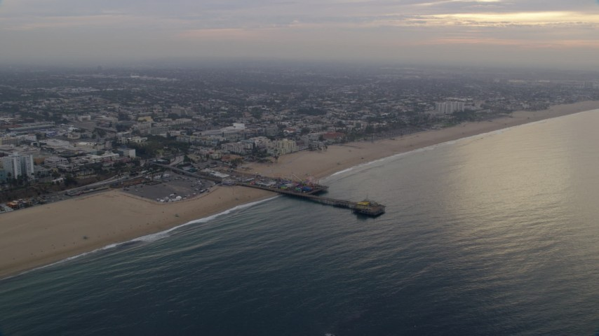 8K stock footage aerial video of Santa Monica Pier, seen from the ocean at sunrise, Santa Monica, California Aerial Stock Footage AX0156_169 | Axiom Images