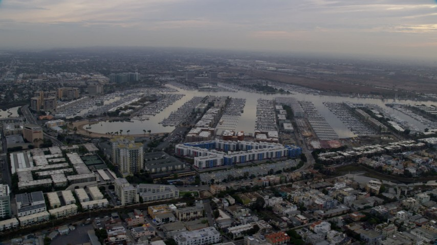 8K stock footage aerial video of boats docked in the harbor at sunrise in Marina Del Rey, California Aerial Stock Footage AX0156_173 | Axiom Images