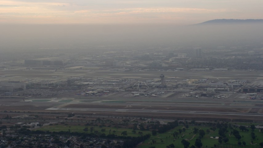 8K stock footage aerial video of LAX in a thick cloud covering, sunrise, Los Angeles, California Aerial Stock Footage | AX0156_179