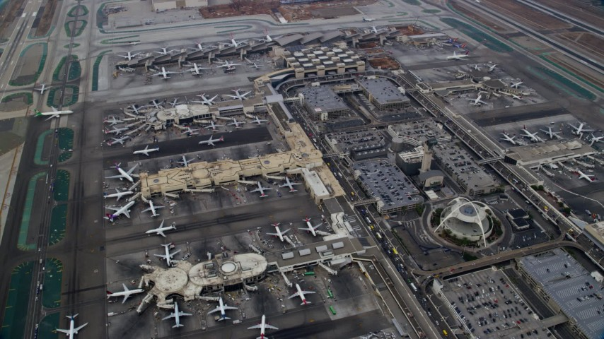 8K stock footage aerial video flying over LAX, sunrise, Los Angeles, California Aerial Stock Footage | AX0156_182