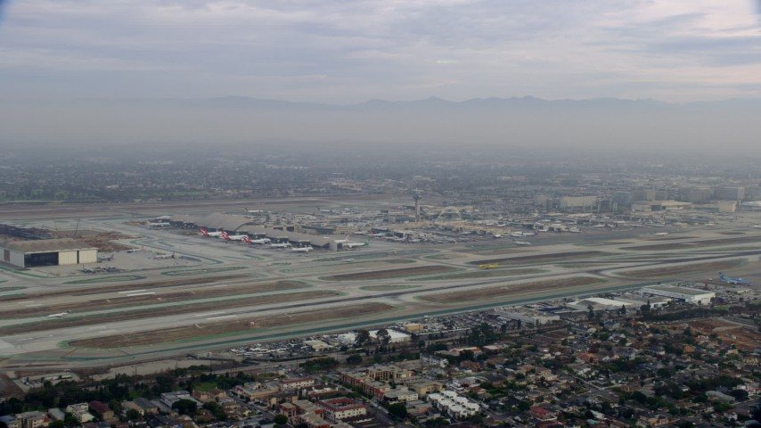 8K stock footage aerial video of LAX at sunrise on a cloudy day, Los Angeles, California Aerial Stock Footage | AX0156_188