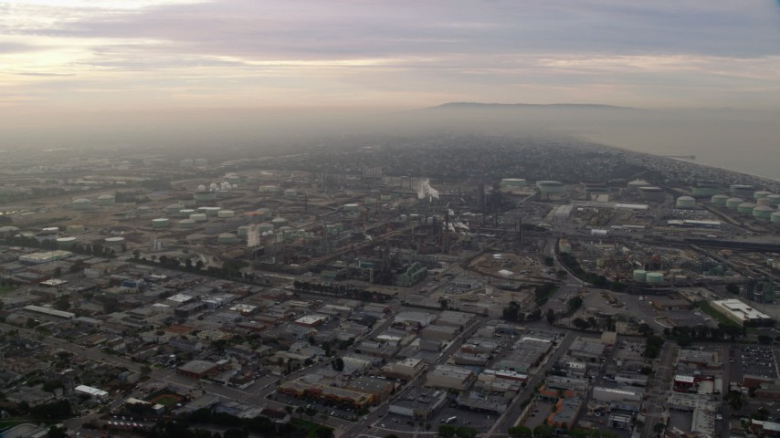 8K stock footage aerial video of an oil refinery in El Segundo, California, sunrise Aerial Stock Footage | AX0156_195