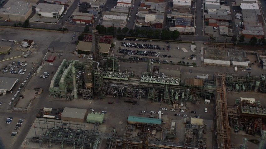 8K stock footage aerial video flying by an oil refinery structures in the morning in El Segundo, California Aerial Stock Footage | AX0156_197