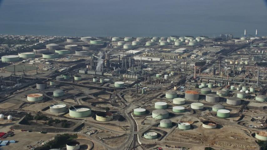 8K stock footage aerial video flying over oil refineries, cloudy, El Segundo, California Aerial Stock Footage | AX0157_005