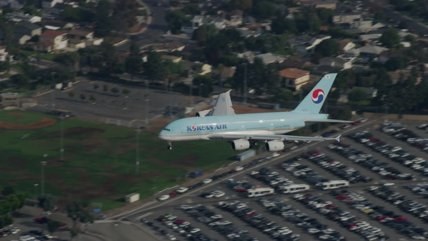 8K stock footage aerial video tracking Korean Air A380 landing at LAX, cloudy, Los Angeles, California Aerial Stock Footage | AX0157_006