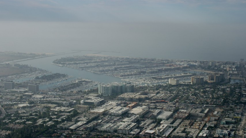 8K stock footage aerial video of harbors and industrial area on cloudy day, Marina Del Rey, California Aerial Stock Footage | AX0157_010