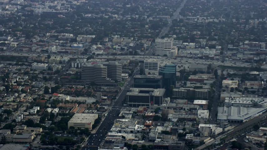 8K stock footage aerial video passing by office buildings and freeways, haze, Santa Monica, California Aerial Stock Footage | AX0157_012