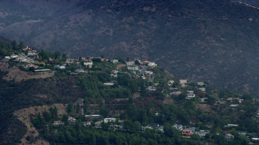 8K aerial video of hillside homes in the Santa Monica Mountains, Pacific Palisades, California Aerial Stock Footage   AX0157_015