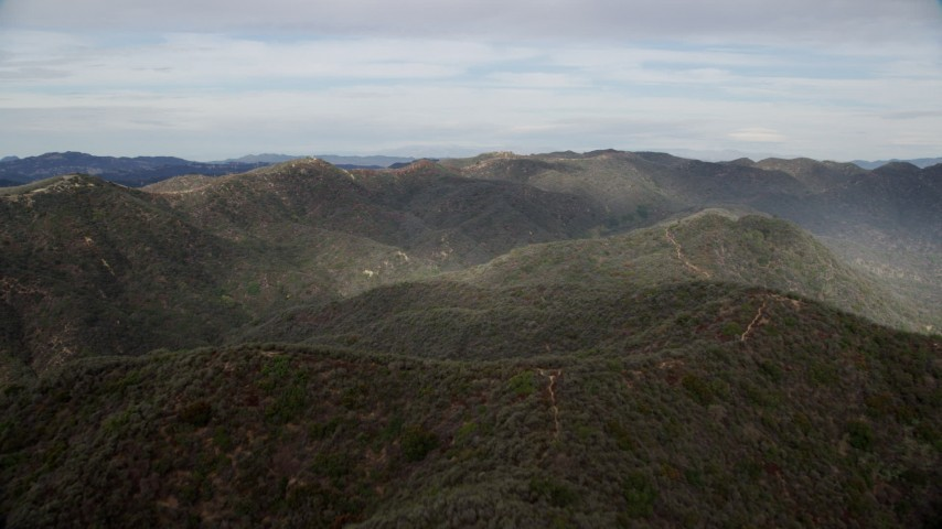 8K stock footage aerial video of rolling green Santa Monica Mountains, California Aerial Stock Footage | AX0157_016