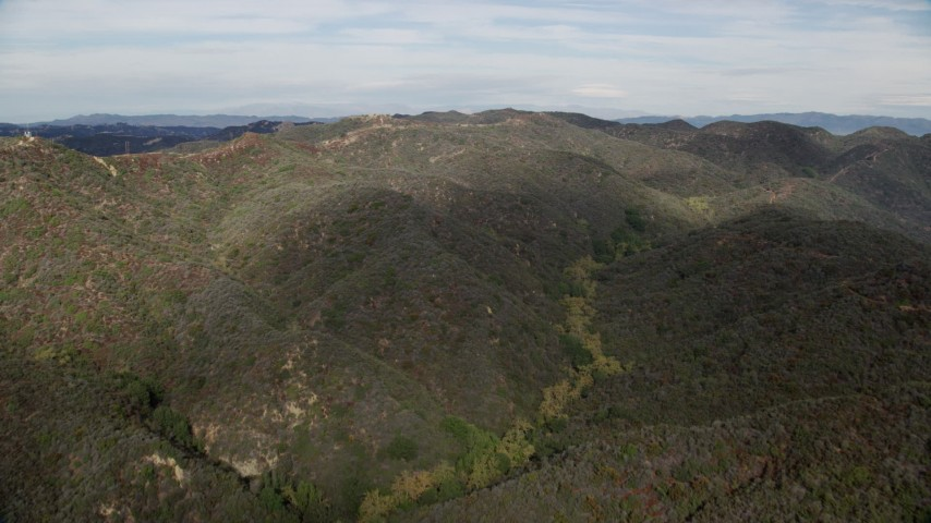 8K stock footage aerial video of green Santa Monica Mountains in California Aerial Stock Footage | AX0157_017