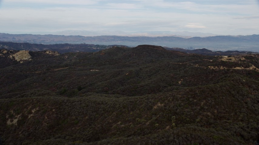 8K aerial video flying over green Santa Monica Mountains in California Aerial Stock Footage | AX0157_019