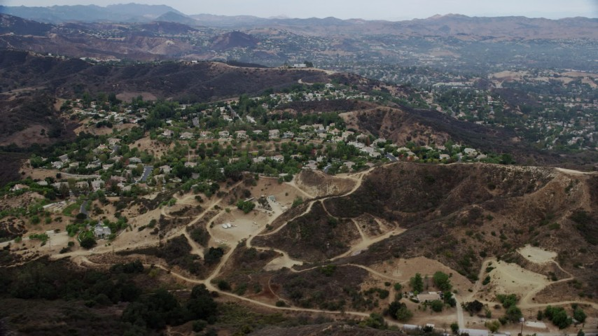 8K stock footage aerial video of a small neighborhood in the hills of Topanga, California Aerial Stock Footage | AX0157_021