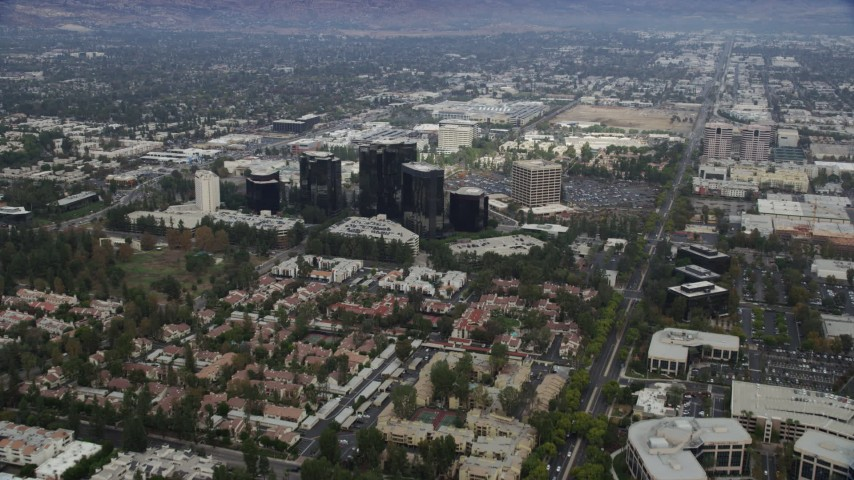 8K stock footage aerial video of apartment complexes and Warner Center office buildings, Woodland Hills, California Aerial Stock Footage | AX0157_023