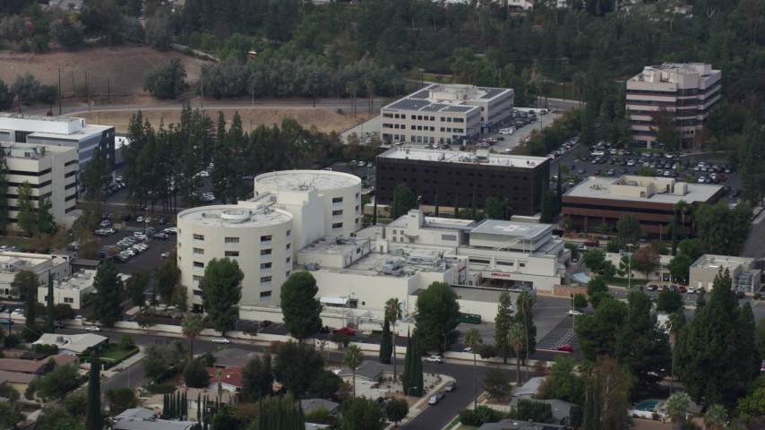 8K stock footage aerial video approaching West Hills Hospital in West Hills, California Aerial Stock Footage | AX0157_031