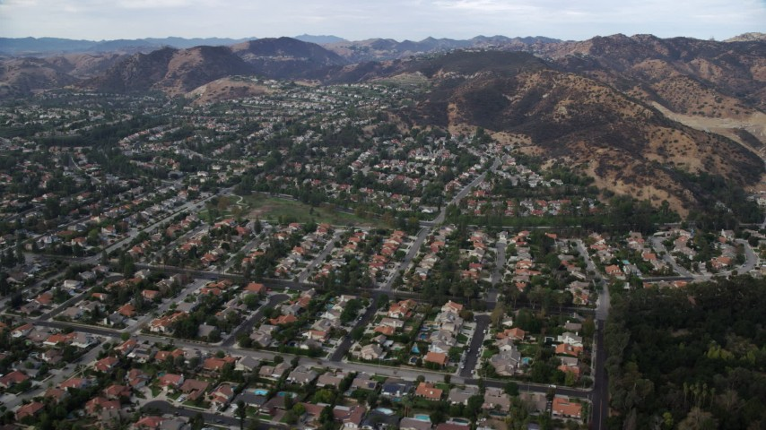 8K stock footage aerial video assing neighborhoods with tract homes in West Hills, California Aerial Stock Footage | AX0157_036