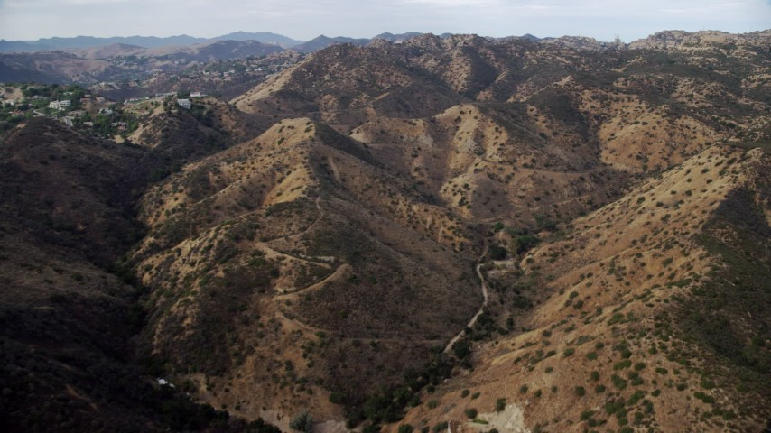 8K stock footage aerial video flying over hills in Canoga Park, California Aerial Stock Footage | AX0157_038