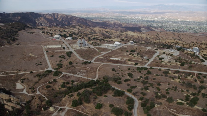 8K stock footage aerial video approaching roads and buildings of the Rocektdyne aerospace testing facility, Brandeis, California Aerial Stock Footage | AX0157_047