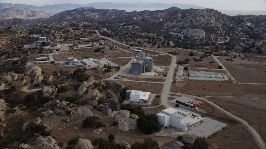 8K stock footage aerial video orbiting buildings at the Rocketdyne aerospace testing facility in Brandeis, California Aerial Stock Footage | AX0157_049
